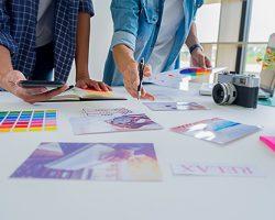 Asian advertising designer creative start-up team discussing ide